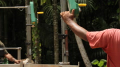 A Man operates a Lumber Mill in the Jungle of PALAU Stock Footage