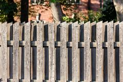 Wooden fence used as notice board Stock Photos