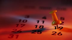 Pan shot of Push pin on a calendar Stock Footage