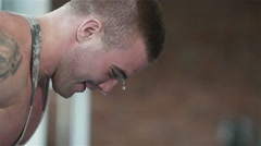 Sweaty bodybuilder working out intensively. Close-up Stock Footage