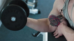 Close-up of a young athletes' arm exercising with weights Stock Footage