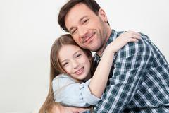 Father and daughter giving himself a hug. Stock Photos