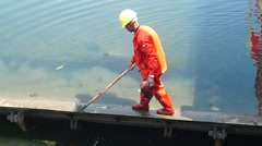 Stock Video Footage of Sanitation workers to clean up the river rubbish