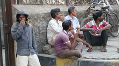 Local Indian men sitting and talking on the street of Mumbai. Stock Footage