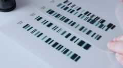 Forensic scientist compares DNA profiles, zoom in - stock footage