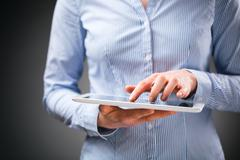 Business Woman with a Tablet Stock Photos