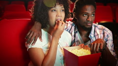 Cute couple watching a movie Stock Footage