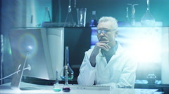 Scientist is working and Thinking in Laboratory - stock footage