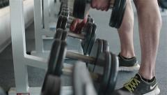 Using metal barbells fixed on stall. Close-up Stock Footage