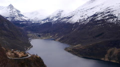 A view along the Geiranger Fjord. Geiranger in background Stock Footage