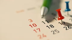 Dolly shot Push pin on a calendar - stock footage