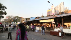 People passing by a local street market in Mumbai. Stock Footage