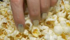 Taking pop-corns  during game 4K 3840X2160 UHD footage - Tasty pop-corn takin Arkistovideo