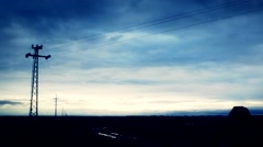 Electric poles in  soil field Stock Footage