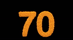 Number 70 in fiery burning digits on black Stock Footage