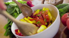Chef stirring vegetable salad closeup slow motion Stock Footage