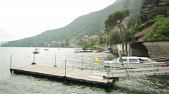 Small wooden pier on the lake. Como Lake, Italy Stock Footage