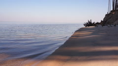 The sandy sea shore with calm water. Stock Footage