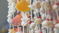 Sea shell mobile hand craft - stock footage