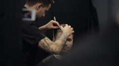 Barber Cuts the Hair in the Barbershop. Slow Motion Stock Footage
