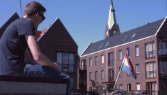 Chilling, in front of a dutch flag. Stock Footage