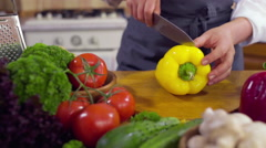 Chef carving a fresh pepper slow motion Stock Footage