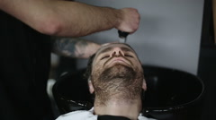 Man Barber Washing Male Hair in a Barbershop - stock footage