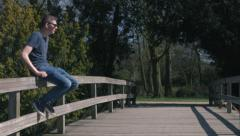 Sitting on a bridge Stock Footage