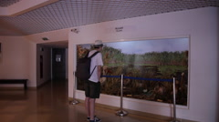 Young man, student observing stuffed pelicans in museum Stock Footage