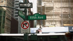 Time lapse showing Fifth Ave and West 42nd Street Sign in New York City Stock Footage