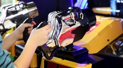 Kids are playing in SEGA Transformers Video Arcade Game in Game center Stock Footage