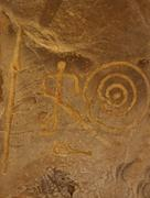 Ancient petroglyph with hunters figures Stock Photos