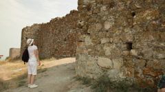 Tourist visiting castle ruins, old medieval fortress, historic landmark, walls Stock Footage