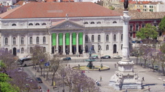 Rossio square in the central Lisbon with a monument of the king Pedro IV from Stock Footage