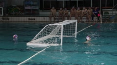 Water Polo Goalkeeper Waiting For Action, Spare Ball In A Water Behind The Goal Stock Footage