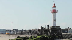 Lighthouse and pier in Trouville harbor, Normandy, France, Europe Stock Footage