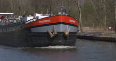 Tanker transport ship passing canal Europe Stock Footage