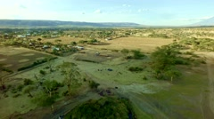 African church in a village with kids at sunset by a well, moving aerial shot Stock Footage