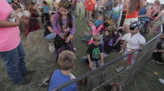 Kids pet roosters in a pet farm Stock Footage