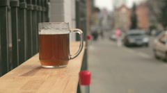 A beer glass on the bar counter on the street near bar Stock Footage