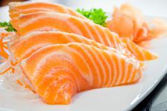 Salmon sashimi or shake / sake served with preserved ginger Stock Photos