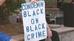 Black on black crime protester  Stock Footage