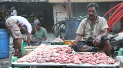 Muslim man selling meat at the street market in Mumbai. Stock Footage