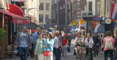 The Netherlands Amsterdam city life North Holland busy street crowded people 4K Stock Footage