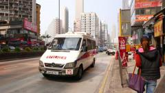 Different car traffic on the street: taxi, police minibus, bus, minivan Stock Footage