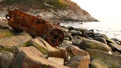 The wreckage on rocky coast: rusty ship engine skeleton Stock Footage