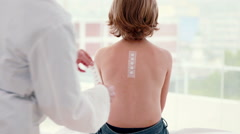 Doctor sticking patch test at her patient Stock Footage