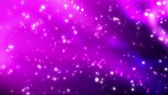 Sparkling spheres bokeh particles against a violet and purple background Stock Footage