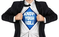 Businessman showing Know your role words underneath his shirt Stock Illustration