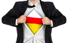Businessman showing South Ossetia flag underneath his shirt Stock Illustration